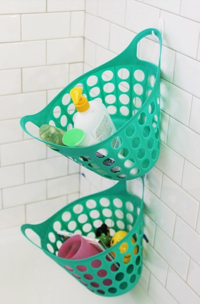 bins hanging on command hooks in the shower