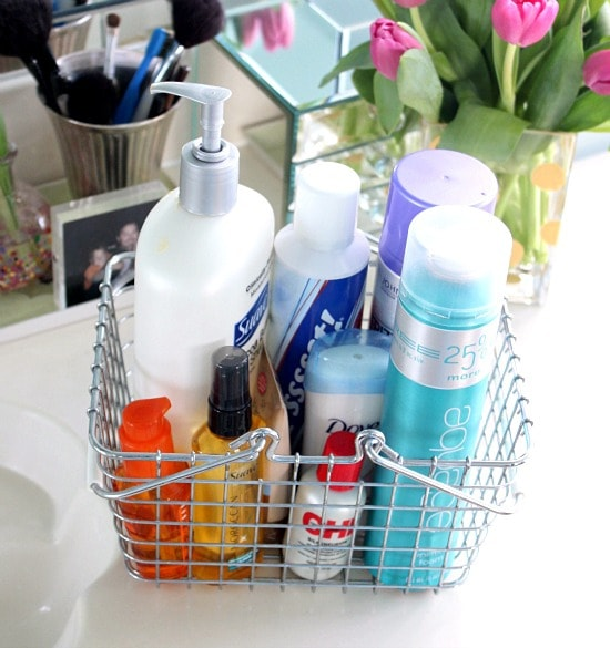Wire basket on a counter containing hair and bath products