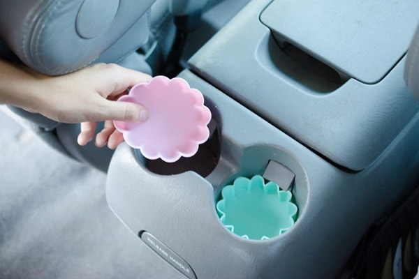 Silicone cupcake liners inside cup holders in a car