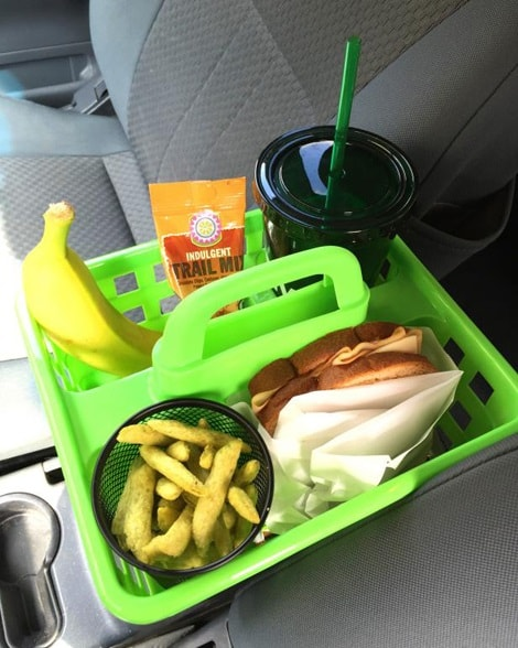 A green shower caddy containing food and drinks